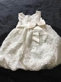 Beautiful white dress with diamanté detail bow