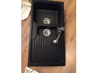 Black modern kitchen sink with mixer tap with shower head