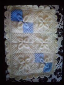 Brand new handmade aran baby shawl