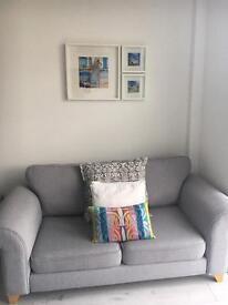 DFS two seater grey sofa like new!