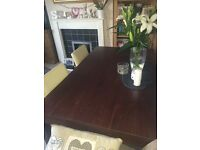 Beautiful six seater wooden walnut table with four ivory faux leather chairs
