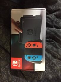 BRAND NEW NINTENDO SWITCH NEON RED AND BLUE 32GB UNOPENED BOXED