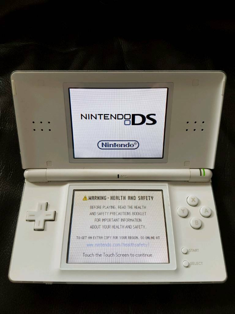 White Ds Nintendo console with in car charger