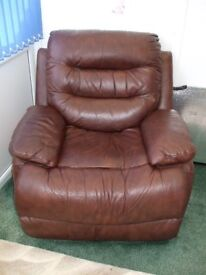 2 reclining brown leather arm chairs
