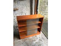 Teak bookcase/shelving unit with sliding glass doors