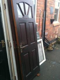 Exterior wooden door with clear glass