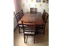 6 SEATER DARK WOOD DINING TABLE EXTENDS TO SEAT 10 PEOPLE - 6 CHAIRS INCLUDED
