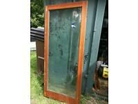 Wooden double glazed patio doors.