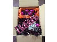 Box of pink / purple Christmas decorations