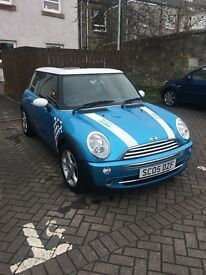 Electric blue Mini Cooper - john Cooper edition