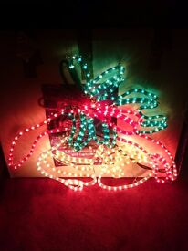 Christmas swinging bells rope light silhouette