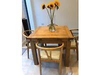 Four seater solid oak extending dining table & chairs
