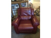 A generously sized, sturdy, red leather fully reclining armchair in excellent condition.