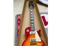 Beautiful Electric guitar Epiphone Les Paul Cherry Sun burst