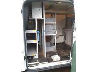 Transit van racking / van internal racking, with approximately 12 hard storage crates.