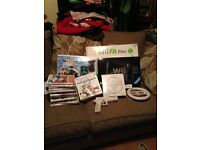 Black Nintendo Wii, Wii fit plus, Disney infinity, games and accessories