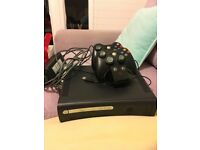 Bargain Xbox 360 with controllers and charging pad.