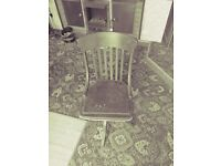 old vintage wooden swivel chair