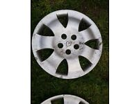 "Renault 4 x 15"" wheel trims."