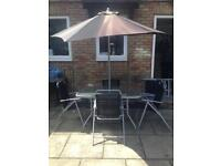 Garden outdoor furniture set. Table, 4 chairs and parasol. Collect today
