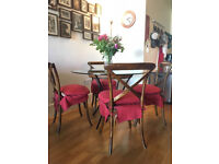 Dining table and assorted chairs