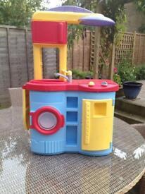 Plastic toy kitchen