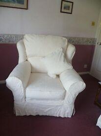sofa set plus footstool, cream cotton covers.