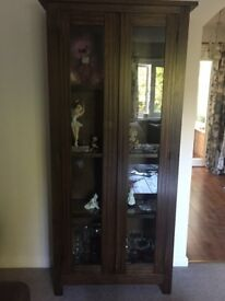 Dark solid wood cabinet with glass