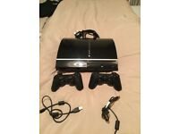 PS3 with x2 controllers HDMI lead and x22 games