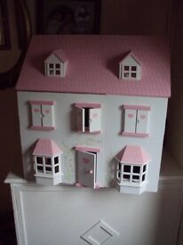 dolls house wooden pink/white with opening shutter windows wooden elc people and some furniture