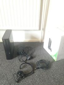 Xbox 360 E console with cables