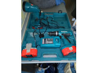 Makita 8390D Combi Drill Driver with torch, charger and three batteries.