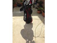Set of magregor golf clubs