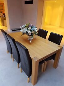 Solid oak table, contemporary, 1 leaf, seats 6-8 people, good condition, sturdy legs, 2 available