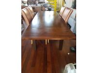 Solid wood board/dinning room table and 4 leather chairs