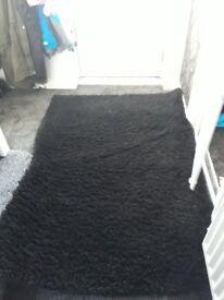 black shaggy rug