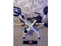Brand new exercise bike and toning belt, never used