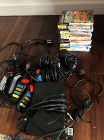 Playstation 2 with mics, game controllers and quiz game controllers & 10 games!