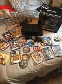 X2 Ps2 console with 17 games , steering wheel x2 controllers