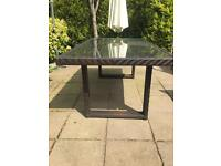 Marks and Spencer Glass Top Brown Rattan Dining Table
