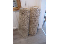 2 x CREAM SHAGGY RUGS AND FREE DOORMAT