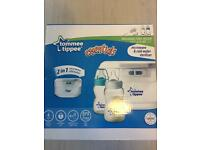 Brand new tommee tippee microwave sterilliser with bottles