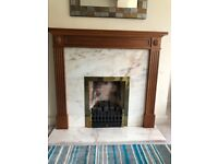 Solid hardwood mantel with granite hearth and back complete with inset gas coal effect fire