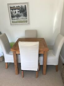 solid dining table & chairs Neptune linen covers in excellent condition. Fire retardant labels