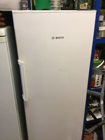 Upright Bosch fridge for sale.