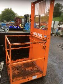 Forklift safety cage.