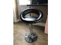 2x black bar stools with chrome bases - used