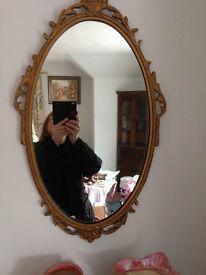 Clark Eaton oval mirror