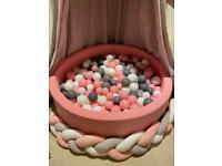Pink foam ball pond with balls