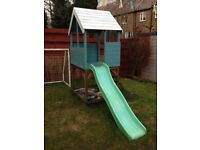 Outdoor playhouse with chute